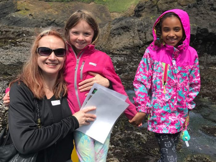 Volunteer with kids on field trip